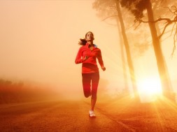 Athlete running on the road in morning sunrise training for mara