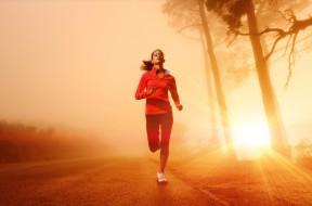 Athlete running on the road in morning sunrise training for mara