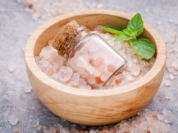Closeup Himalayan Pink Salt In Wooden Bowl And Bottle  With Pepp