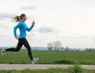 pretty young woman in blue jogging (running) outdoors